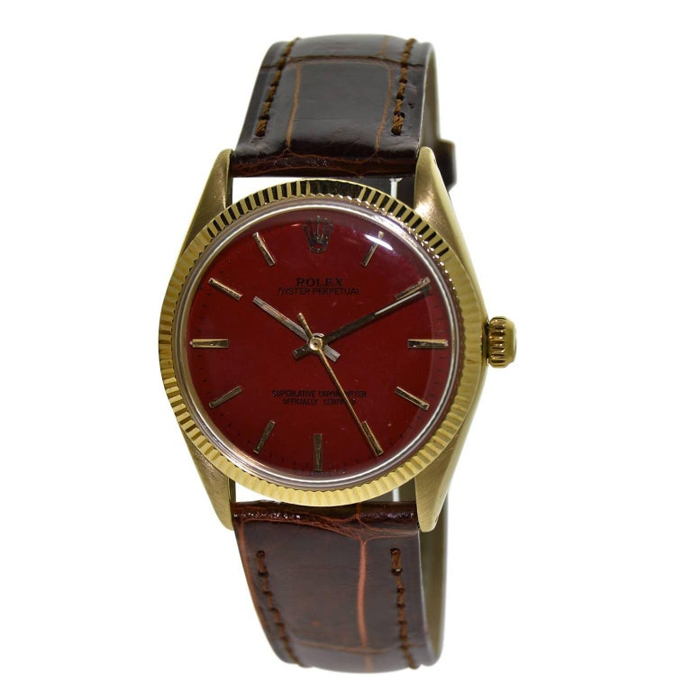 Rolex Yellow Gold Custom Red Dial Oyster Perpetual Wristwatch, circa 1960s