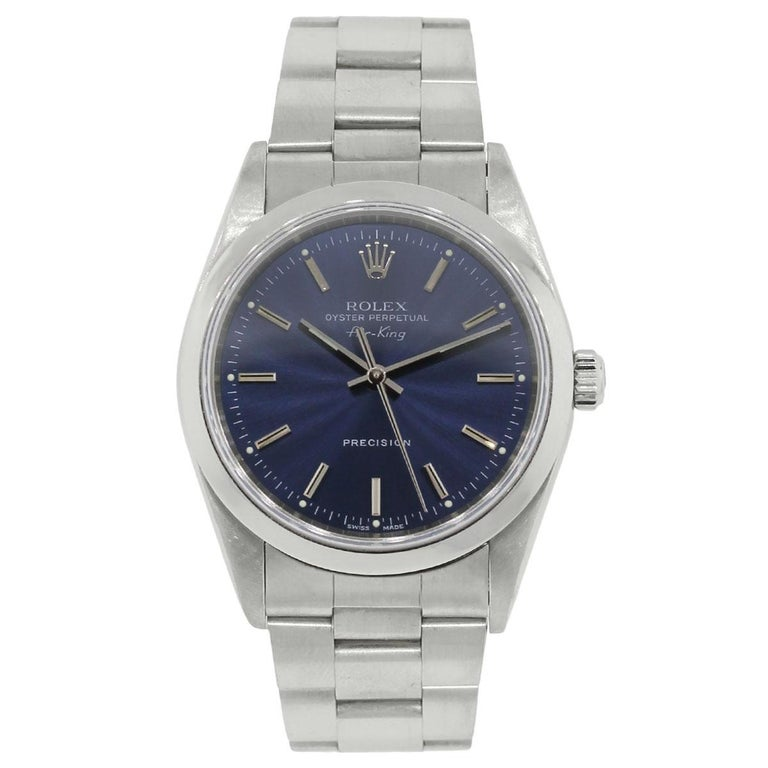 Brand: Rolex MPN: 14000 Model: Air King Case Material: Stainless steel Case Diameter: 34mm Crystal: Sapphire crystal Bezel: Stainless steel smooth bezel Dial: Blue dial Bracelet: Stainless steel oyster band Size: Will fit a 6.75″ wrist Clasp: Fold