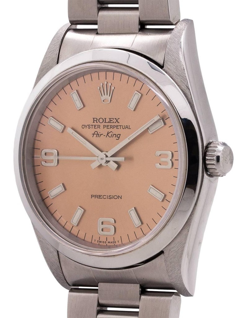 Rolex stainless steel Airking ref 14000, W serial # circa 1995 Explorer style dial. Featuring a 34mm diameter case with smooth bezel, sapphire crystal, and original rose dial with popular Explorer style 3 6 9 configuration. Powered by self winding