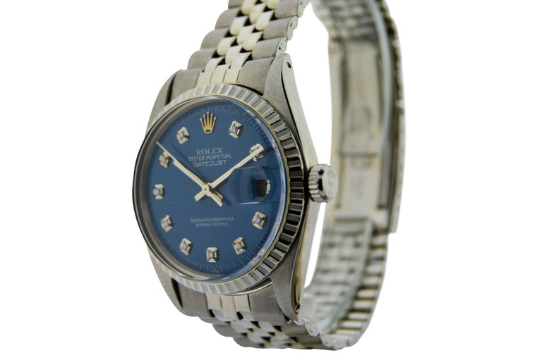 FACTORY / HOUSE: Rolex  STYLE / REFERENCE: Datejust / 1601  METAL / MATERIAL: Stainless Steel  DIMENSIONS:  44mm  X  38mm CIRCA: 1970's MOVEMENT / CALIBER: 26 Jewels / 1570 DIAL / HANDS: Blue Diamond Replacement Dial / Baton Hands ATTACHMENT /