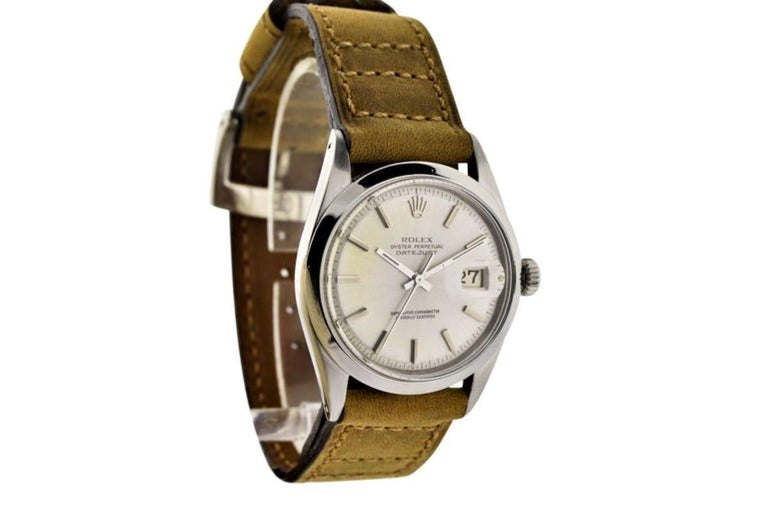 FACTORY / HOUSE: Rolex Watch Company STYLE / REFERENCE: Datejust / 1603 METAL / MATERIAL: Stainless Steel  DIMENSIONS:  43mm  X  36mm CIRCA: 1968/69 MOVEMENT / CALIBER: 1570 / 26 Jewels / Perpetual Winding DIAL / HANDS: Original with Silver Baton