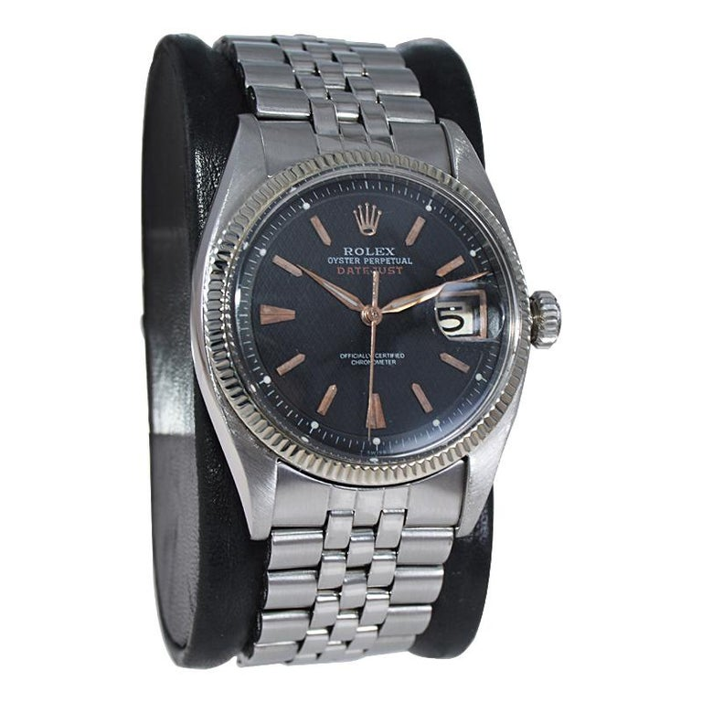 FACTORY / HOUSE: Rolex Watch Company STYLE / REFERENCE: Early Datejust / 6305 METAL / MATERIAL: Stainless Steel and White Gold CIRCA / YEAR: 1953 DIMENSIONS / SIZE: 44mm X 37mm MOVEMENT: Winding/Jewels /Cal. 740 DIAL / HANDS: Black with Rose gold