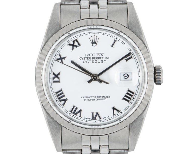 A 36 mm Datejust in stainless steel by Rolex. Features a white Roman dial and an iconic fluted white gold bezel. The Jubilee bracelet comes with an Oyster deployant clasp. Fitted with sapphire crystal and a self-winding automatic movement.  In