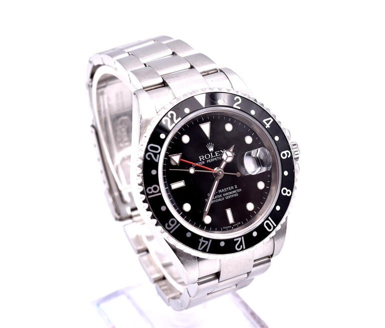 Movement: automatic Function: hours, minutes, seconds, GMT, date Case: 40mm stainless steel case with rotatable black bezel, screw-down crown, sapphire crystal Band: stainless steel Oyster bracelet with fold over clasp  Dial: black dial with red GMT