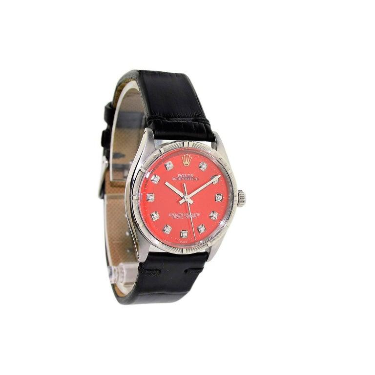 FACTORY / HOUSE: Rolex Watch Company STYLE / REFERENCE: Machined Bezel / Ref. 1007 METAL / MATERIAL: Stainless Steel DIMENSIONS: 39mm X 34mm CIRCA: 1960's MOVEMENT / CALIBER: Perpetual Winding / 26 Jewels / Cal. 1560 DIAL / HANDS: Red Replacement