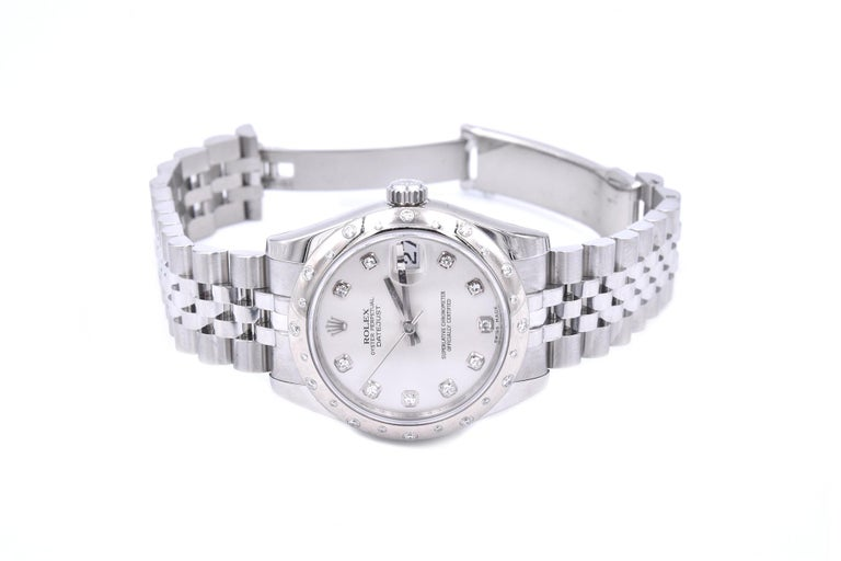 Movement: automatic Function: hours, minutes, seconds, date Case: round 31mm white gold sprinkled diamond bezel, solid case back, sapphire protective crystal Band: Stainless steel jubilee bracelet with deployment clasp Dial: Silver diamond dial,