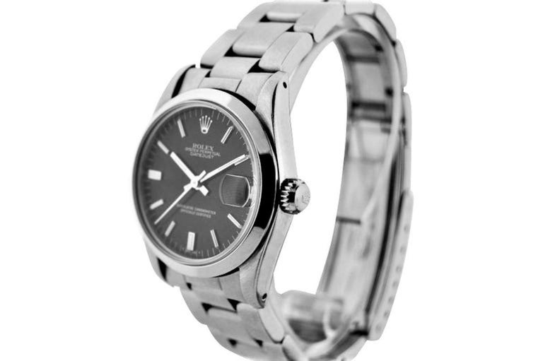 FACTORY / HOUSE: Rolex Watch Company STYLE / REFERENCE: Oyster Perpetual / Midsize METAL / MATERIAL: Stainless Steel  DIMENSIONS: 30mm diameter / 36mm including lugs CIRCA: 2000 plus MOVEMENT / CALIBER: Perpetual Winding / 26 Jewels  DIAL / HANDS: