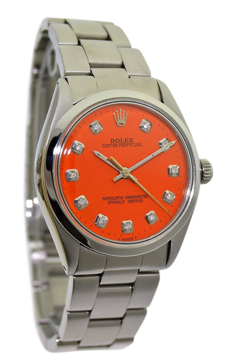 FACTORY / HOUSE: Rolex Watch Company STYLE / REFERENCE: Oyster Perpetual / Ref. 5500 METAL / MATERIAL: Stainless Steel  CIRCA: 1970's DIMENSIONS: 39mm X 34mm MOVEMENT / CALIBER: Perpetual Winding / 26 Jewels / Cal. 1520 DIAL / HANDS: Custom Orange