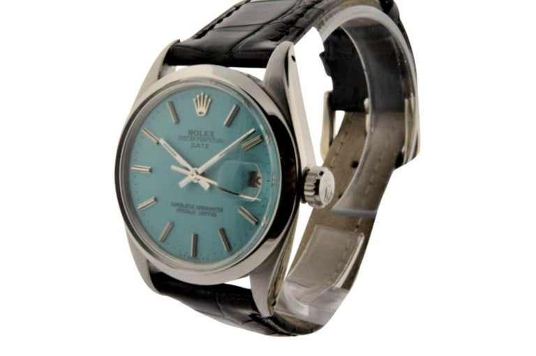 FACTORY / HOUSE:  Rolex Watch Company STYLE / REFERENCE: Oyster Perpetual Date / Ref. 1500 METAL / MATERIAL: Stainless Steel DIMENSIONS: 41mm  X  34mm CIRCA: 1970's MOVEMENT / CALIBER: 26 Jewels / Cal. 1570 DIAL / HANDS: Custom Turquoise Blue w/