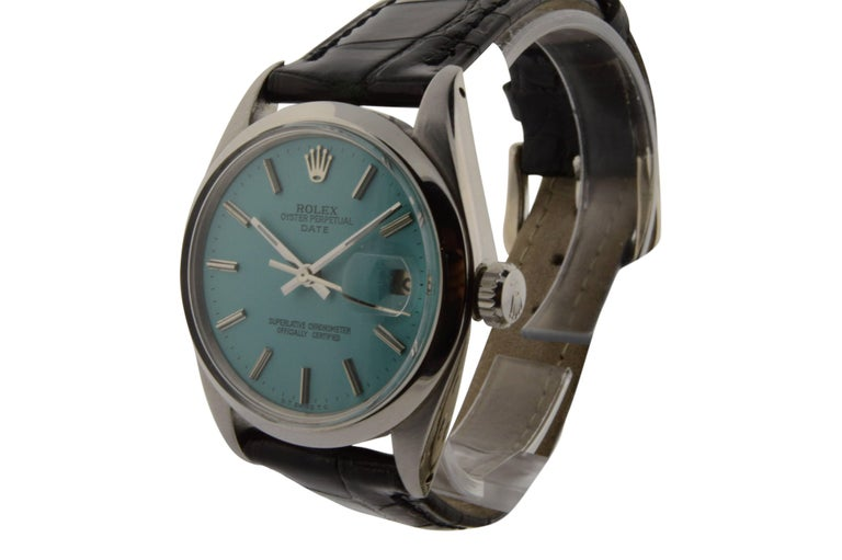 FACTORY / HOUSE:  Rolex Watch Company STYLE / REFERENCE: Oyster Perpetual Date / Ref. 1500 METAL / MATERIAL: Stainless Steel DIMENSIONS: 41mm  X  34mm CIRCA: 1970's MOVEMENT / CALIBER: 26 Jewels / Cal. 1570 DIAL / HANDS: Blue w/ Batons / Baton