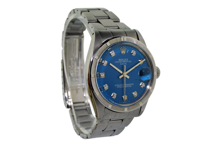 FACTORY / HOUSE: Rolex Watch Company STYLE / REFERENCE: 1501 / Oyster Perpetual Date CIRCA: 1970's MOVEMENT / CALIBER: 26 Jewels / 1570 DIAL / HANDS: Blue Diamond Dial / Baton Hands DIMENSIONS: 39mm X 35mm ATTACHMENT / LENGTH:  19mm Steel Oyster