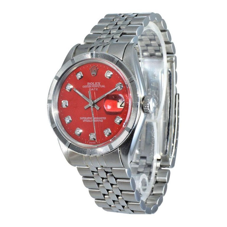 FACTORY / HOUSE: Rolex Watch Company STYLE / REFERENCE: Oyster Perpetual / Date / Ref. 1500 METAL / MATERIAL: Stainless Steel DIMENSIONS:  39mm  X  34mm CIRCA: 1970's MOVEMENT / CALIBER: Perpetual / 26 Jewels / Cal. 1570 DIAL / HANDS: Custom Red