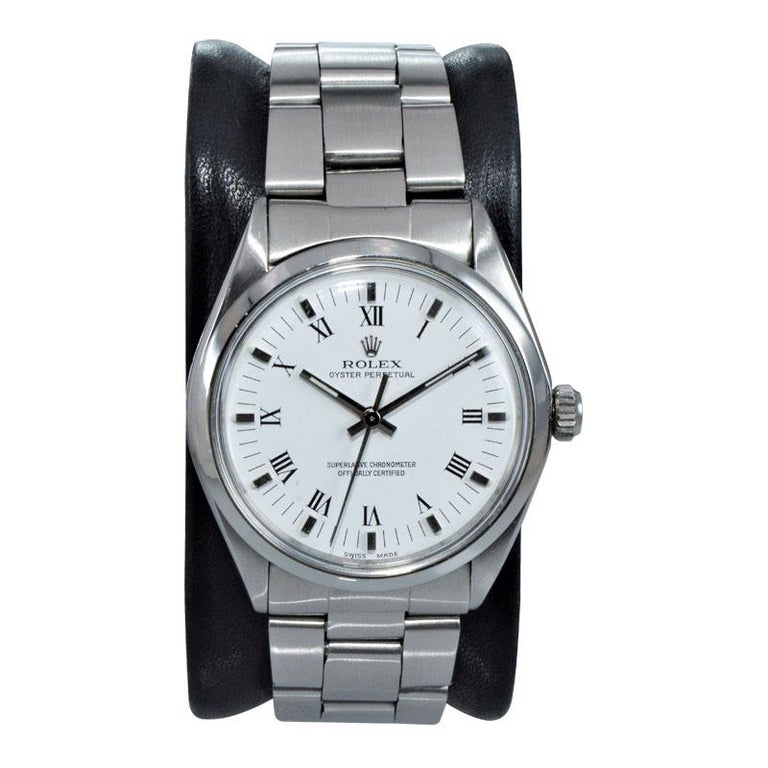 FACTORY / HOUSE: Rolex Watch Company STYLE / REFERENCE: Oyster Perpetual / Reference 1002 METAL / MATERIAL: Stainless Steel CIRCA / YEAR: 1975 DIMENSIONS / SIZE: 40mm x 34mm MOVEMENT / CALIBER: Manual Winding / 26 Jewels / Cal. 1570 DIAL / HANDS: