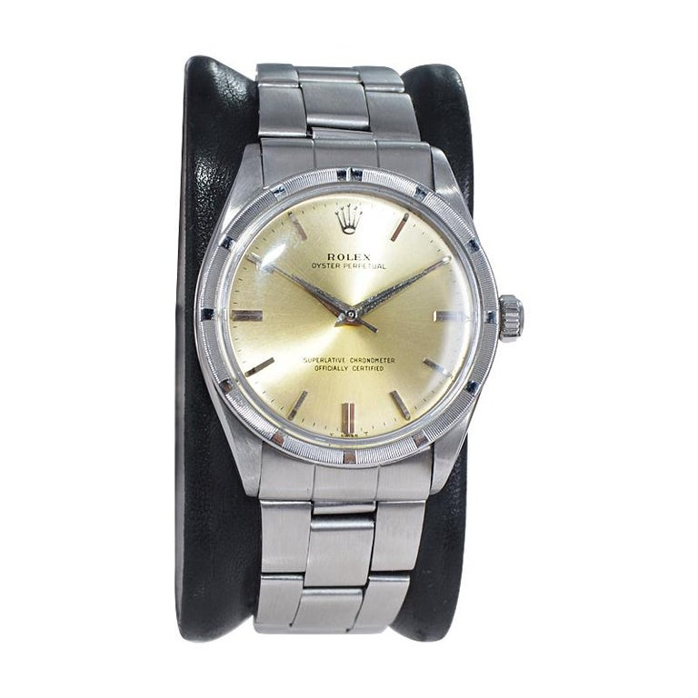 FACTORY / HOUSE: Rolex Watch Co. STYLE / REFERENCE: Oyster Perpetual / Ref. 1007 METAL / MATERIAL: Stainless Steel CIRCA / YEAR: 1964-65 DIMENSIONS / SIZE: 39mm x 34mm MOVEMENT / CALIBER: Perpetual (Automatic) Winding / 26 Jewels  DIAL / HANDS: