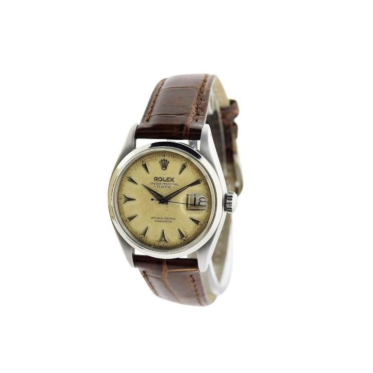 FACTORY / HOUSE: Rolex Watch Company STYLE / REFERENCE: Oyster Perpetual / Reference 6534 METAL / MATERIAL: Stainless Steel  CIRCA: 1957 / 1958  DIMENSIONS: 42mm X 35mm MOVEMENT / CALIBER: Perpetual Winding / 25 Jewels / Cal. 1030 DIAL / HANDS: