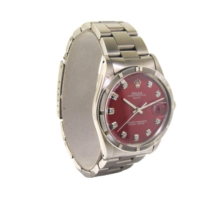 FACTORY / HOUSE: Rolex Watch Company STYLE / REFERENCE: Oyster Perpetual / 5500 METAL: Stainless Steel  CIRCA: 1981 MOVEMENT / CALIBER: Perpetual Winding / 27 Jewels  DIAL / HANDS: Custom Red Dial with Diamonds / Baton Hands  /Index