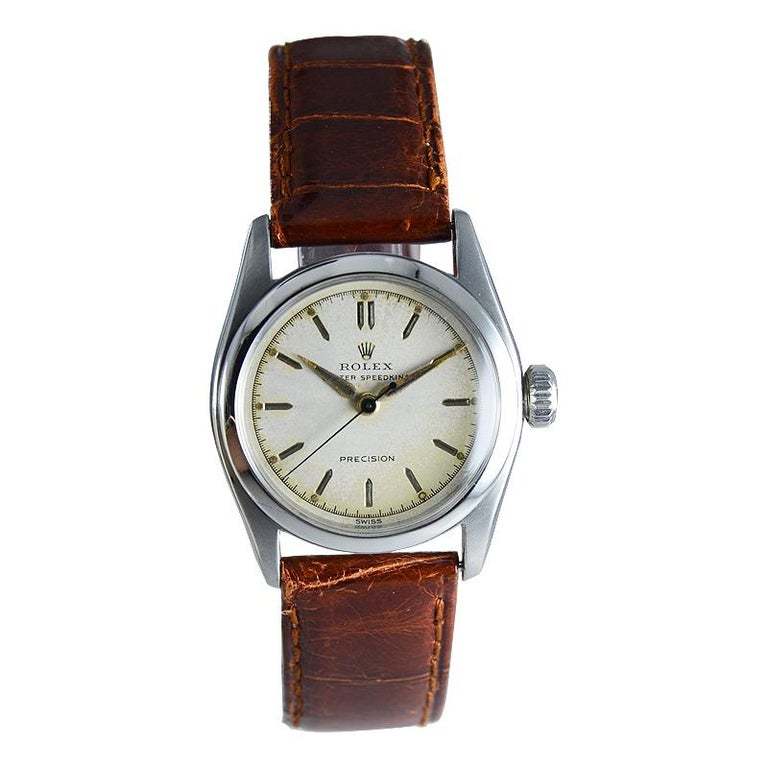 FACTORY / HOUSE: Rolex Watch Company STYLE / REFERENCE: 3/4 Size Precision / Oyster Speedking METAL / MATERIAL: Stainless Steel  CIRCA: 1953 DIMENSIONS: 36mm X 30mm MOVEMENT / CALIBER: Manual Winding / 17 Jewels  DIAL / HANDS: Original Silvered with