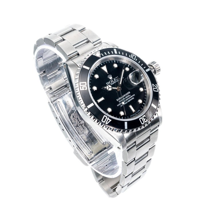 Men's Rolex submariner stainless steel, oyster band wristwatch.  model 16610 circa 1994.    Length: 47.27mm Width: 40mm Band width at case: 20mm Case thickness: 12.56mm Crystal: sapphire Dial: black Other: Model 16610 Serial # 5180186 135.2