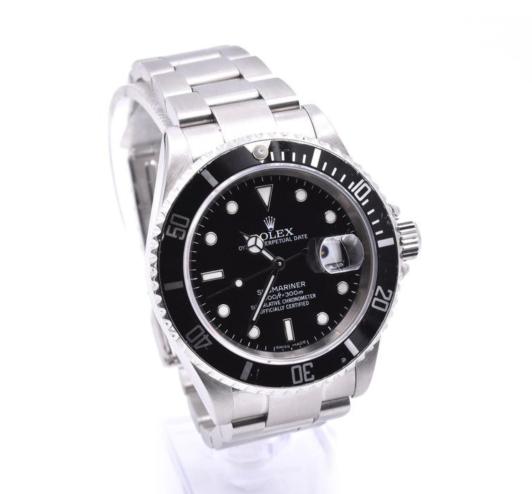 Movement: automatic Function: hours, minutes, seconds, date Case: 40mm stainless steel case with back bezel, screw-down crown, sapphire crystal Band: stainless steel bracelet with locking deployment clasp Dial: black dial with luminescent hands and