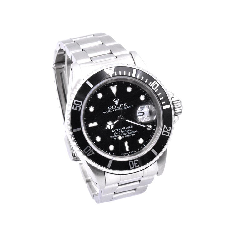 Movement: automatic  Function: hours, minutes, seconds, date at 3 o'clock Case: 40mm stainless steel case, rotatable time-lapse diver's bezel, acrylic crystal Dial: black dial with cream hour markers and hands Band: Rolex stainless steel oyster lock