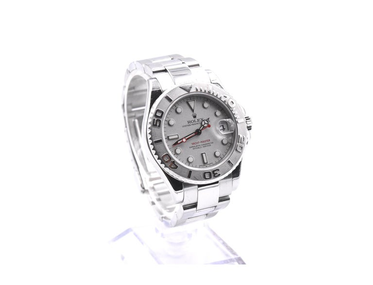 Movement: automatic Function: hours, minutes, seconds, date Case: round 35mm stainless steel case with bi-directional bezel, sapphire protective crystal, screw-down crown, water resistant to 100 meters Dial: silver dial with luminescent steel hands,