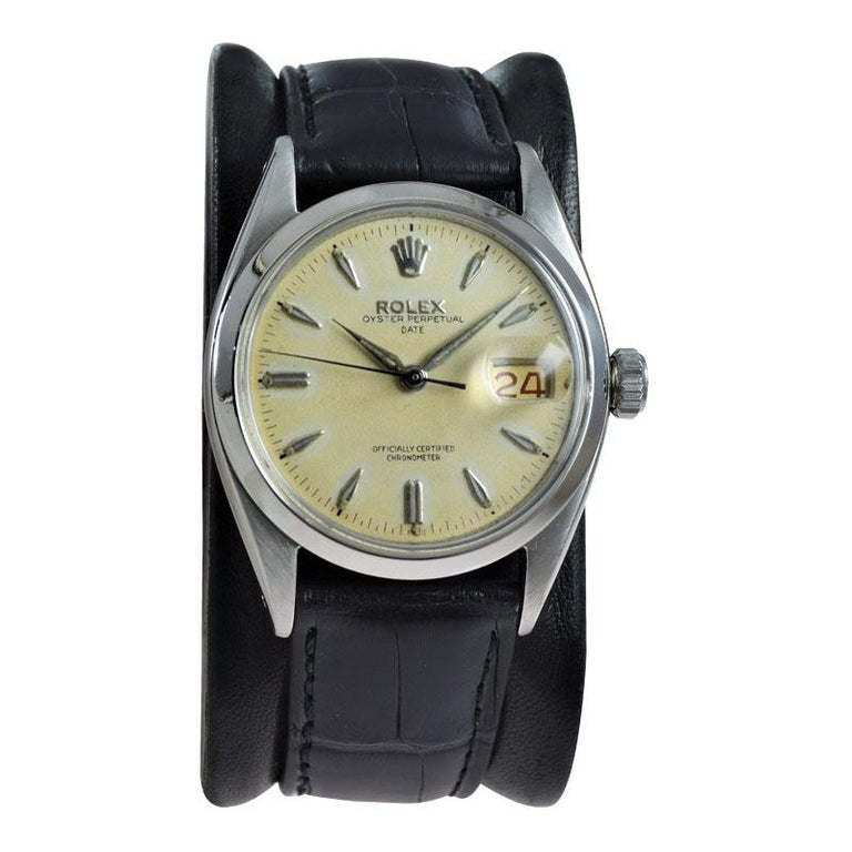 FACTORY / HOUSE: Rolex Watch Company STYLE / REFERENCE: Oyster Perpetual .Date / Reference 6534 METAL / MATERIAL: Stainless Steel  CIRCA / YEAR: 1957 DIMENSIONS / SIZE: 42mm x 34mm MOVEMENT / CALIBER: Manual Winding / 26 Jewels / Caliber 1030 DIAL /