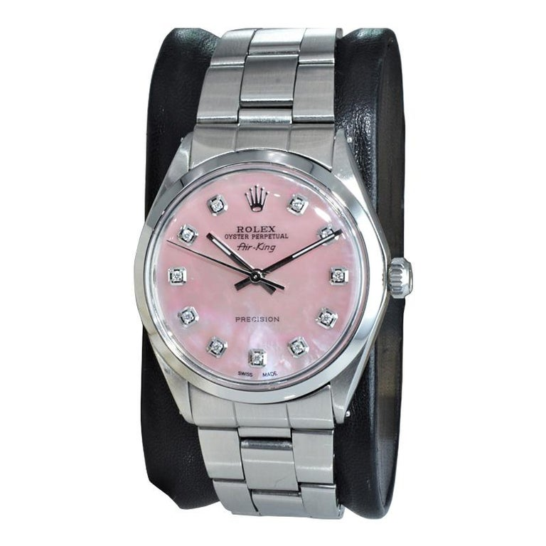 FACTORY / HOUSE: Rolex Watch Company STYLE / REFERENCE: Air King / Reference 1002 METAL / MATERIAL: Stainless Steel  CIRCA / YEAR: 1972 DIMENSIONS / SIZE: 39mm x 34mm MOVEMENT / CALIBER: Perpetual Winding / 26 Jewels / Cal. 1570 DIAL / HANDS: Custom