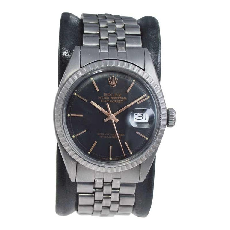 FACTORY / HOUSE: Rolex Watch Company STYLE / REFERENCE: Datejust / Reference 1600 METAL / MATERIAL: Stainless Steel with Carbonized Finish CIRCA / YEAR: 1964 DIMENSIONS / SIZE: 43mm x 36mm MOVEMENT / CALIBER: Perpetual Winding / 26 Jewels / Caliber
