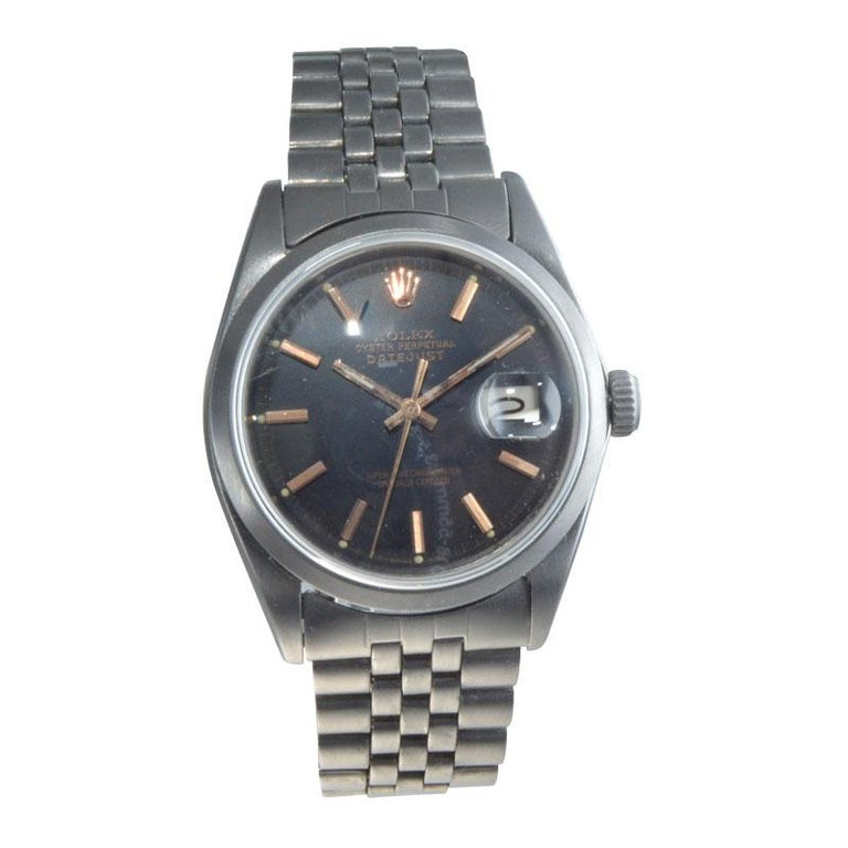 FACTORY / HOUSE: Rolex Watch Company STYLE / REFERENCE: Datejust / Ref. 1601 METAL / MATERIAL: Stainless Steel / Charcoal Finish CIRCA / YEAR: Late 1960's DIMENSIONS / SIZE: 43mm x 36mm MOVEMENT / CALIBER: Perpetual Winding / 26 Jewels / 1570 DIAL /