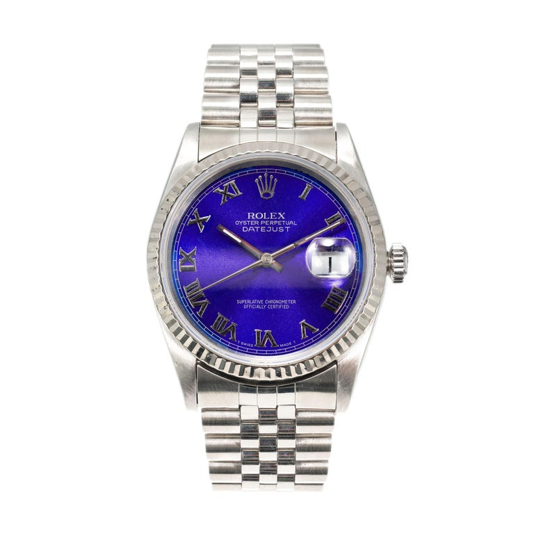 Stainless-steel Rolex Datejust model 16234 with 18k white gold bezel. Custom colored rich blue Rolex dial with Roman numerals. Sapphire crystal and Jubilee band.  18k white gold Stainless steel 96.2 grams Length: 8.5 inches and easily