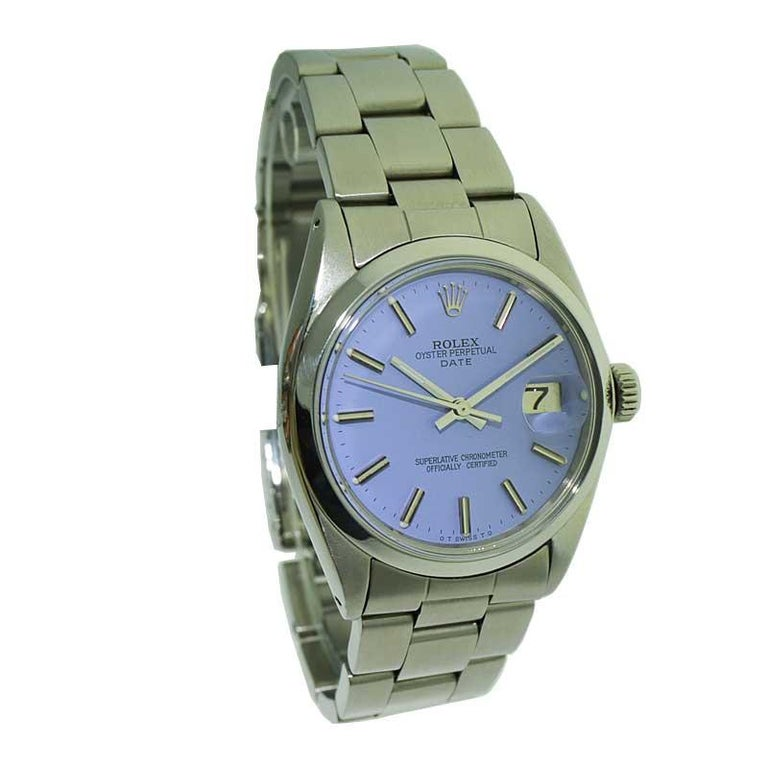 FACTORY / HOUSE: Rolex Watch Company STYLE / REFERENCE: Oyster Perpetual Date METAL / MATERIAL: Stainless Steel CIRCA / YEAR: 1970's DIMENSIONS / SIZE: 39mm X 34mm MOVEMENT / CALIBER: Perpetual winding DIAL / HANDS: Custom Lavender Dial/ straight