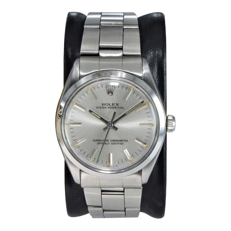 FACTORY / HOUSE: Rolex Watch Co. STYLE / REFERENCE: Oyster Perpetual / Ref. 1002 METAL / MATERIAL: Stainless Steel CIRCA / YEAR: 1986-87 DIMENSIONS / SIZE: 40mm x 34mm MOVEMENT / CALIBER: Perpetual Winding / Jewels / Cal.1570 DIAL / HANDS: Original