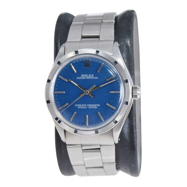 FACTORY / HOUSE: Rolex Watch Company STYLE / REFERENCE: Oyster Perpetual / Reference 1007 METAL / MATERIAL: Stainless Steel CIRCA / YEAR: Early 1970's DIMENSIONS / SIZE: 39mm x 34mm MOVEMENT / CALIBER: Perpetual Winding / 26 Jewels  DIAL / HANDS: