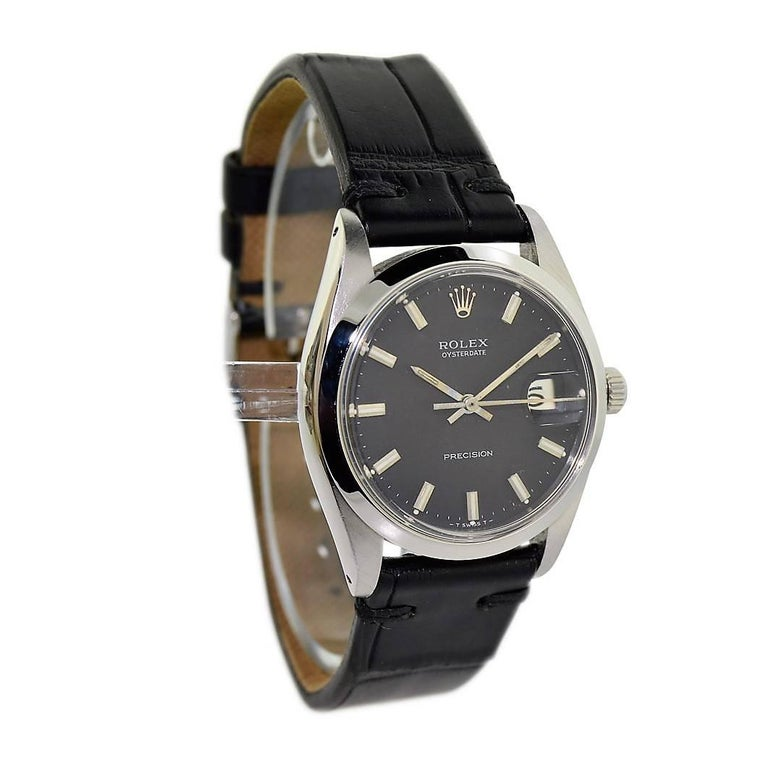 FACTORY / HOUSE: Rolex Watch Company STYLE / REFERENCE: Oysterdate / 6694 METAL / MATERIAL: Stainless Steel DIMENSIONS:  39mm  X  34mm CIRCA: 1969 / 1970 MOVEMENT / CALIBER: Manual Winding / 17 Jewels  DIAL / HANDS: Original Black w/ Baton Markers /