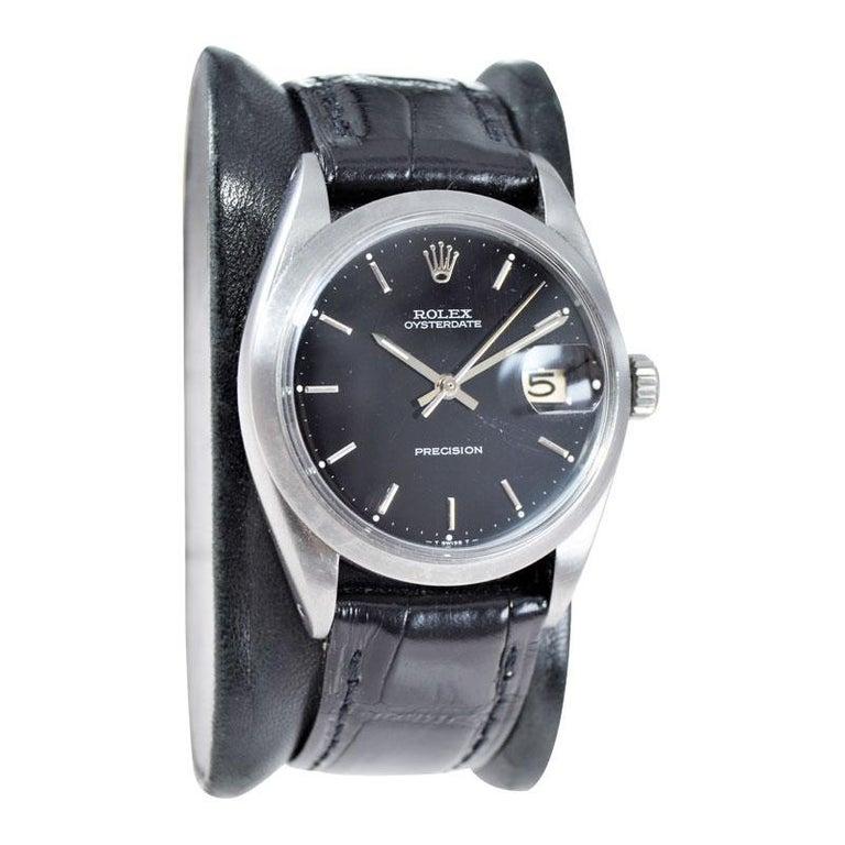 Women's or Men's Rolex Steel Oysterdate Black Dial Watch, circa 1969 For Sale