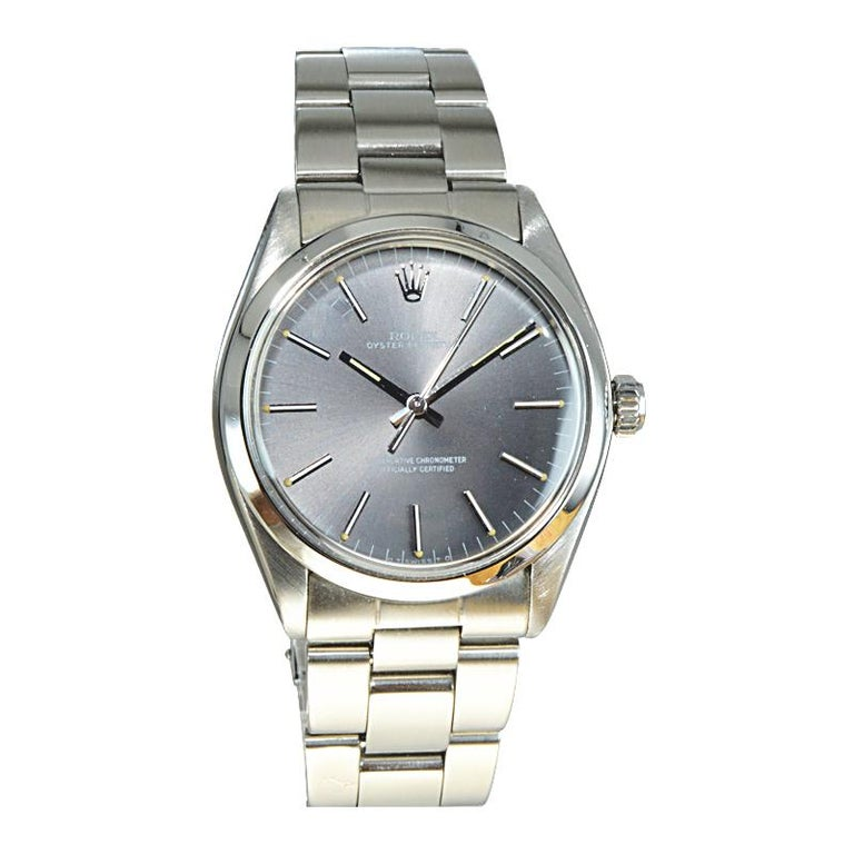 FACTORY / HOUSE: Rolex Watch Company STYLE / REFERENCE: Round Oyster Perpetual / Ref. 1002 METAL / MATERIAL: Stainless Steel  CIRCA / YEAR: Early 1960's DIMENSIONS / SIZE: 40mm x 34mm MOVEMENT / CALIBER: Manual Winding / 26Jewels  DIAL / HANDS: