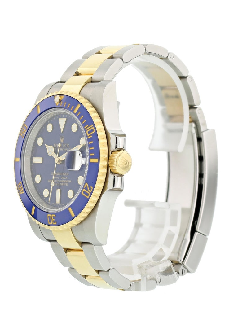 Rolex Oyster Perpetual Date Submariner 116613 Mens Watch. 40mm Stainless steel case. Unidirectional rotating 18K yellow gold bezel with a blue ceramic top ring. Blue dial with yellow gold-tone hands and luminous dot hour markers. Minute markers