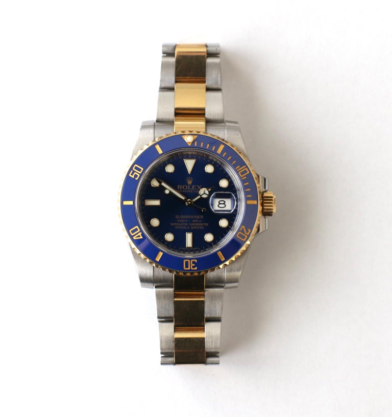 Rolex Submariner 116613LB Two Tone Ceramic Blue Bezel, Blue Dial Box Papers    Model: 116613LB Serial/Year: Random - 2011 or newer, card dated 2015  Movement: Automatic 3135 Dial:Blue w/ luminescent hands and hour markers Bezel: Ceramic