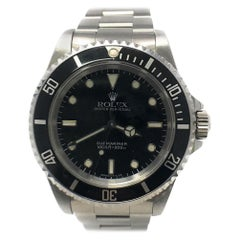 Rolex Submariner 14060 with Band and Silver Dial