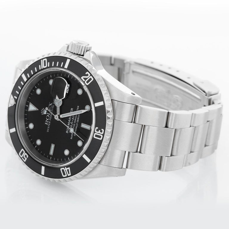 Rolex Submariner 16610 Stainless Steel Men's Watch - Automatic winding, 31 jewels, Quickset, sapphire crystal. Stainless steel case; rotating bezel with black insert. Black Dial. Stainless steel Oyster bracelet with flip-lock clasp. Pre-owned with