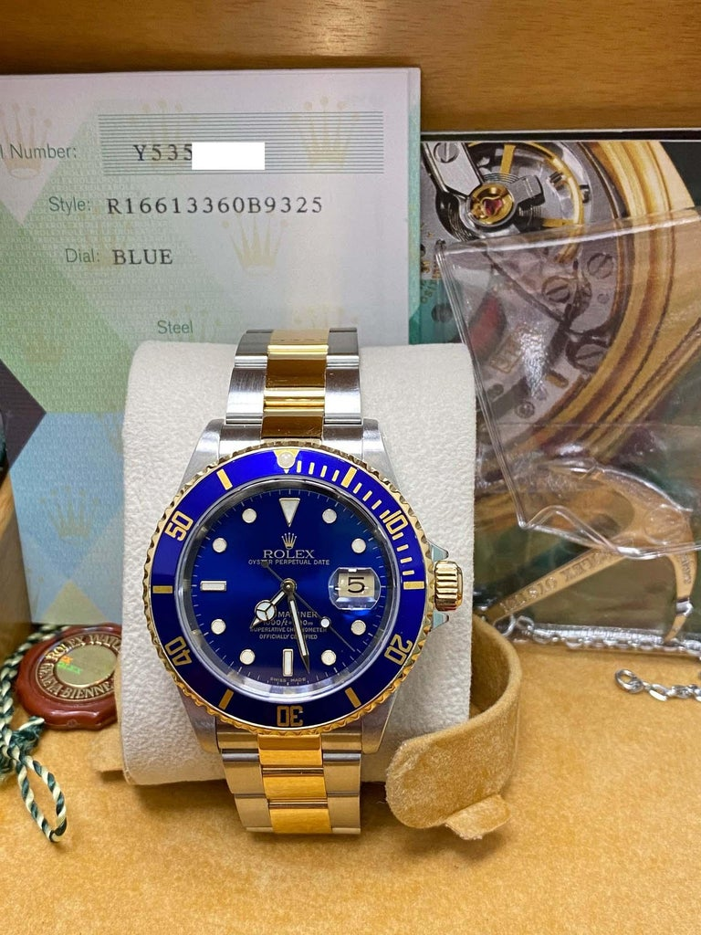 Style Number: 16613     Serial: Y535****   Year: 2003     Model: Submariner     Case Material: Stainless Steel     Band: 18K Yellow Gold & Stainless Steel     Bezel:  Blue     Dial: Blue     Face: Sapphire Crystal     Case Size: 40mm     Includes:
