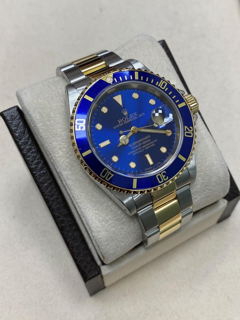 Style Number: 16613     Serial: A644***   Year: 2000     Model: Submariner      Case Material: Stainless Steel     Band: 18K Yellow Gold & Stainless Steel     Bezel: Blue     Dial: Blue     Face: Sapphire Crystal     Case Size: 40mm     Includes: