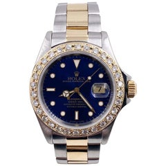 Rolex Submariner 16613 Blue Dial Diamond Bezel 18 Karat Yellow Gold Stainless
