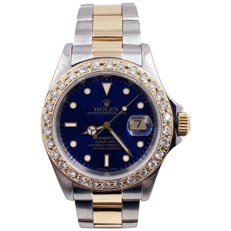 Rolex Submariner 16613 Blue Dial Diamond Bezel 18 Karat Yellow Gold Stainless For Sale