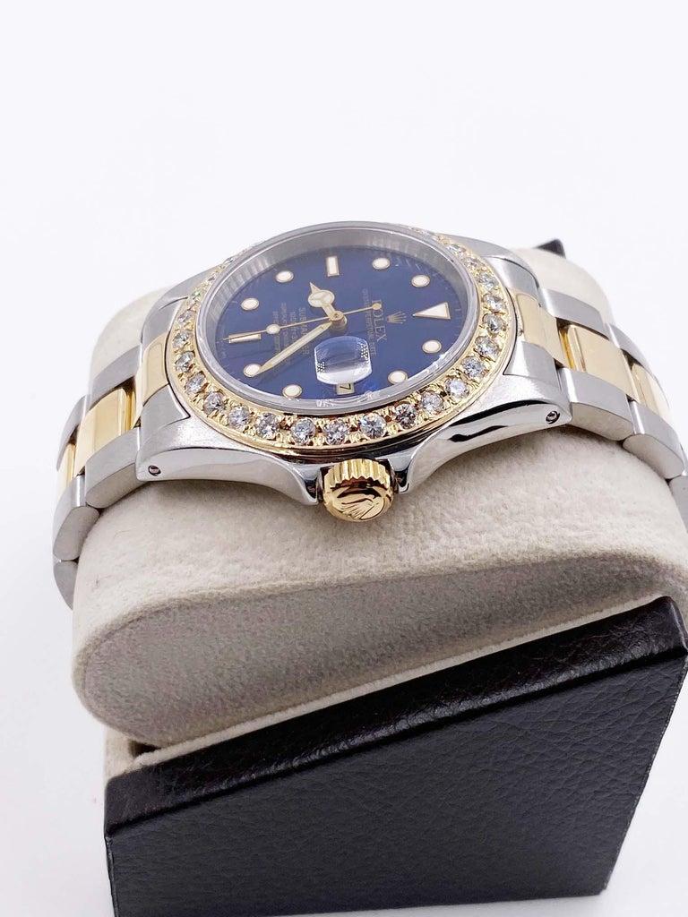 Men's Rolex Submariner 16613 Blue Dial Diamond Bezel 18 Karat Yellow Gold Stainless For Sale