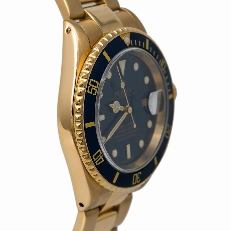 Rolex Submariner 16618, Blue Dial, Certified and Warranty In Good Condition For Sale In Miami, FL