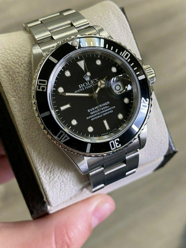 Style Number: 16800  Year: 1987  Serial: 9868***  Model: Submariner  Case: Stainless Steel   Band: Stainless Steel   Bezel: Black   Dial:  Black Spider Web  Face: Sapphire Crystal   Case Size: 40mm   Includes:  -Elegant Watch Box  -Certified