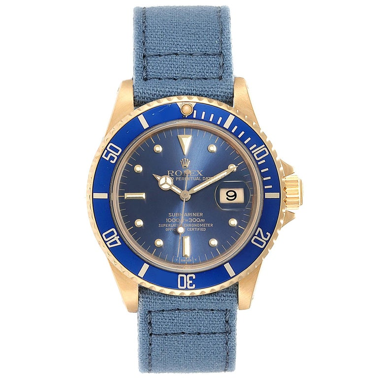 Rolex Submariner 18K Yellow Gold Blue Dial Mens Watch 16808. Officially certified chronometer self-winding movement. 18K yellow gold case 40.0 mm in diameter. Rolex logo on a crown. Original 18k yellow gold bidirectional rotating bezel with a