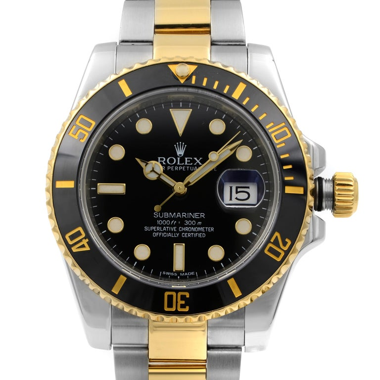 Pre-owned Rolex Submariner 40mm 18k Yellow Gold Steel Black Dial Automatic Men's Watch 116613BKDO. This Beautiful Timepiece: Stainless Steel Case with a Stainless Steel Rolex Oyster Bracelet with 18kt Yellow Gold Center Links, Uni-Directional