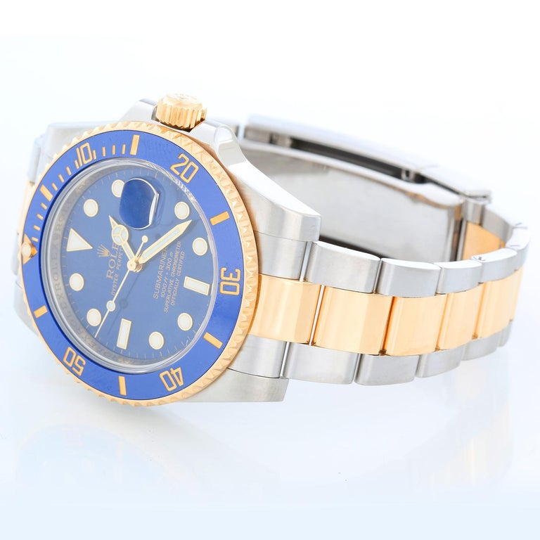 Rolex Submariner 2-Tone Steel & Gold Men's Watch 116613 - Automatic winding, 31 jewels, pressure proof to 1,000 feet. Stainless steel case with 18k yellow gold bezel  (40mm diameter). Blue  dial with luminous markers; date at 3 o'clock. Two tone